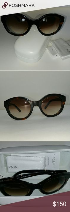 """NEW NINA RICCI sunglasses with Case, Cloth, Bookle New with Case, Cleaning Cloth & Information Booklet NINA RICCI Women's Tortoise Plastic Frame/Brown Gradient Lens? (NRICCISUN-NR3255-C02-51-21-140) ($295 List Price)  Original white clam-shell case included Lens cloth (sealed/ unopened) included Information Booklet included  Dimensions: (LxWxH): 7""""x5""""x5"""" Eye: 51/Bridge: 21/Arm: 140 Scratch- and impact-resistant lens 100% UVA and UVB protection Gender: Women's Frame Material: Plastic Frame…"""
