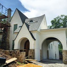 The stone is getting close to being finished on our latest house in Homewood Alabama. Really love how the brick turned out. Stucco And Stone Exterior, Stucco Homes, Brick And Stone, Stone Work, Porte Cochere, Tudor House, Tudor Cottage, Style At Home, Homewood Alabama