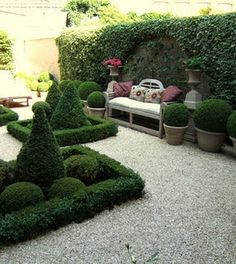 This bench is perfect! Love the potted boxwood balls too!
