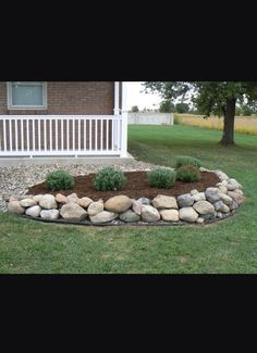 Landscape with mulch and rocks                                                                                                                                                      More