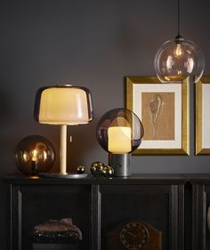 The IKEA EVEDAL and FADO table lamps glow softly atop a black side table, creating an intimate yet elegant mood. Luminaire Led, Luminaire Design, Ikea Fado, Led String Lights, Wall Lights, Lampe Salon Design, Grey Table Lamps, White Lamps, Kerosene Lamp