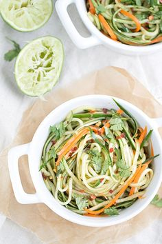 Cucumber Noodles with Sesame Soy Dressing - serving is only 100 calories! If you don't own a julienne peeler to make the noodles, get one! They're the greatest new kitchen tool invention and cost around $10.