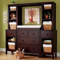 Dresser with hutch (for tv later on).  Use canvas artwork while child is small.  Land of Nod