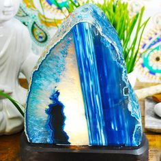 Blue Agate Lamp. Handcrafted with extreme precision this Blue Agate Lamp is a piece of art. Agate is a stone of strength. It was used by the Ancients on the breastplates of armor to give warriors strength and make them victorious in battle. Energetically, it is considered to give strength in both battle and physically.