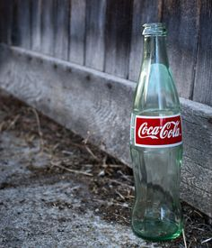 This Coca Cola bottle near a rustic barn brought me back in time.