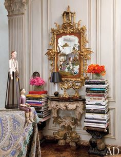 In the entry, an 18th-century English gilt chinoiserie mirror and an Italian console | archdigest.com