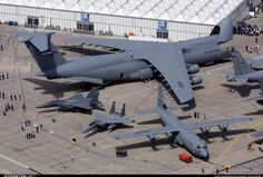The massive C-5 Galaxy, dwarfing a C-130 Hercules.