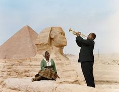 African-American music legend- Louis Armstrong plays for his wife, Lucille, in front of the Sphinx and Great Pyramids in Giza, Egypt (1961)