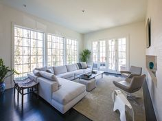 Minotti Hamilton sofa.  B&B metropolitan chairs.  metropolitan home modern family rooms - Google Search