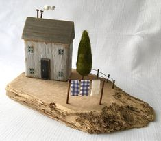 Gorgeous coastal art depicting a little cottage scene made from driftwood which makes a lovely piece of rustic art for the lover of recycled art, driftwood art or seaside art. The perfect new home gift, wedding gift or 5th anniversary gift! This driftwood base has been well drifted and