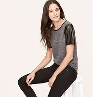 Spacedye Faux Leather Sleeve Tee - We're into the effortless cool of this space dye-meets-faux leather marvel. Scoop neck. Short sleeves. Faux leather trim at neckline and sleeves. Shirttail hem.