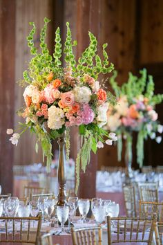 These extravagant centerpieces make a breathtaking statement with hues of light pink, peach and ivory. Photographer: Tracy Autem Photography   Florist: Tami Winn Events   Decor: Gold Dust Vintage Rentals #bridesofnorthtx #centerpiece #northtxbride