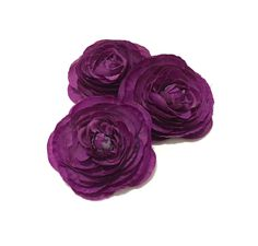 Three mini ranunculus flowers in purple, each one measuring ALMOST 2.5 inches in diameter. PLEASE NOTE: THESE FLOWERS ARE SLIGHTLY SMALLER THAN OTHERS LISTED HERE AND HAVE FEWER LAYERS.  These silk flowers would be great for use on a headband, a hairclip, a flower crown, a Boutonniere, or in a corsage or a bouquet. These artificial flowers are new and have been removed from the stems. THIS LISTING IS FOR THE FLOWER HEADS ONLY. *The flowers are described in this listing as silk flowers  - a…