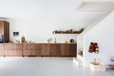 The calm and collected home of Sanne Hop Living Area, Living Spaces, Timber Beds, Long Kitchen, White Backdrop, Its A Wonderful Life, Concrete Floors, Clean Design, Old Houses