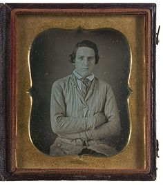 ca. 1850-60's, [daguerreotype portrait of an uncomfortable looking medical student or photographer's assistant, wearing a smock of some kind]