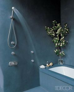 Room/Style: Bathroom, Contemporary Notes: In the lower Manhattan penthouse of star baseball player Mike Piazza and his wife, Alicia, an actress, the open shower and bathtub are paved in polished concrete; the minimalist fittings by Grohe reiterate the pared-down aesthetic. Photographer: Simon Upton Featured in: Irresistible Open Showers Issue: May 2010