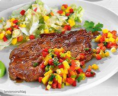 Rezept: Karibische Schweinekoteletts mit fruchtigem Salat