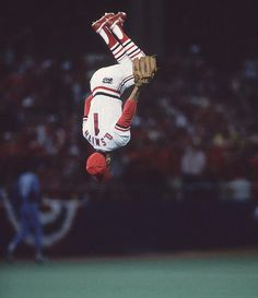 Photographer Ronald Modra perfectly captured the biggest names in sports, like this one of Cardinal's Ozzie Smith's signature backflip. See more stunning baseball photos with Baseball Photos, Sports Photos, Baseball Stuff, Baseball Wall, Baseball Live, Pro Baseball, Soccer Stuff, Sports Images, Football
