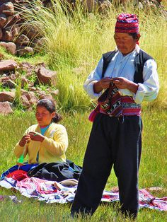 Traditional methods still preserved in PERU. Men knitting and Women spinning yarn / weaving cloth as they go about their daily routine. They can WALK and do this! Uros and Taquile Islands - Day 5 123 by JillScoby, via Flickr