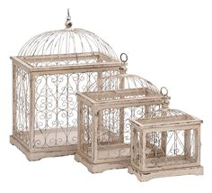 Harvey & Haley Metal Bird Cage with Celestial Designs - Set of 3. Features: Made of high quality metal and wood Spacious interiors Durable and long lasting Suitable for outdoors and indoors  Description: Style your home decor with this exquisitely designed bird cage. If you are bird love, this fascinatingly designed wood and metal set of bird cage is a must-have for your decor. Resting on a flat wooden base and sturdy wooden corners, this stylish bird cage features celestial designs all over…