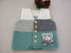 Soft and cozy vest hand knitted in mint,grey and white wool yarn. It is perfect for everyday wear during the cold winter days. It has five wooden buttons . It is available in a beautiful palette of colors suitable for boys and girls. Enjoy dressing baby in this stylish sweater that is comfy