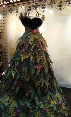 This beautiful woodland gown, is made entirely of paper. I think that I will have it done in dyed cloth, canvas or possibly tussah for the chariot ride for district seven, what do you think?