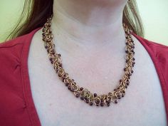 Beaded Shaggy Loops  Bronze rings with wine-colored beads  $25.00