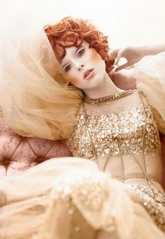 coco rocha. Beautiful copper make-up and ginger curls.  Lame and tulle gown.  Editorial.