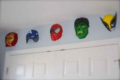 Use Halloween masks to make great, low-cost wall hangings.