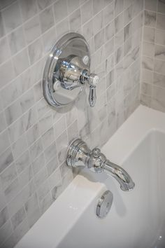 Polished chrome hardware looks great against white marble --> http://www.hgtv.com/design/hgtv-smart-home/2015/kids-bathroom-pictures-from-hgtv-smart-home-2015-pictures?soc=smartpin