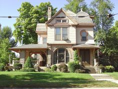 https://flic.kr/p/zTU1Fs | Eclectic Queen Anne North Jackson St. Huntington IN | Some of the details on this eclectic style house resemble those from published plans of Knoxville mail order architect George F. Barber. The keyhole window as seen upstairs was one of Barber's signature details, The overhanging console and bracketed side porch likely date from the early 1900's so its difficult to determine the original appearance. Asbestos-cement siding also makes it more difficult as patterned…