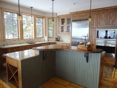 Explore your options and find new ideas from these pictures of kitchen countertops in materials ranging from wood, granite, solid surface and tile to stainless steel.