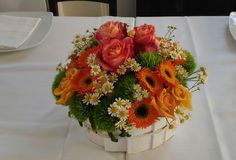 Green centertable with orange flowers