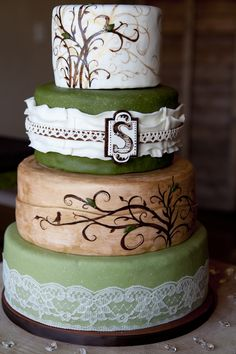 Hand painted and adorned with lace and ruffles...this rustic #wedding #cake is absolutely gorgeous!  Cake by http://sweetandswankycakes.com  Photo Credit: http://sweetandswankycakes.com