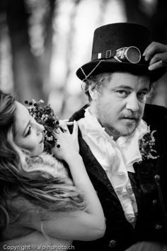 Steampunk wedding couple in Thun, Switzerland. It always takes a while to get comfortable in front of the camera. Here D&D have settled in and look pretty cool.  Steampunk Brautpaar, Hochzeit in Thun, Berner Oberland, Schweiz. Hochzeitsfotografie. Fotograf.