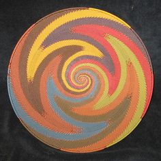 African Zulu Telephone Wire Platter  Wonderful Modern Craft    Fabulous Earth Color Swirls with Rows of Knitted Stitches.