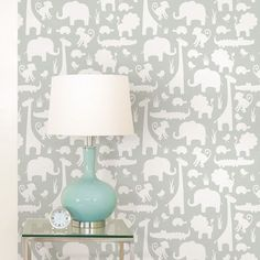 NuWallpaper Its A Jungle In Here Peel And Stick Wallpaper - Grey NU1393  Transform a room with ease with this simple to use It's A Jungle peel and stick wallpaper. The gorgeous design features white silhouettes of animals including monkeys, lions and giraffes on a soft grey background. Ideal for nurseries and bedrooms, simply peel the backing off and apply the high quality wallpaper to any flat surface. If you change your mind the paper can be removed and repositioned without leaving any ...