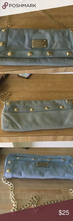 Blue Leather Michael Kors bag Soft leather , blue bag with gold tone chain by Michael Kors, tag says established 1981... has a small pocket inside..it is about 11 inches x 5 1/2 incheschain can go inside and this can be used as a clutch..the leather may need to be cleaned.. Michael Kors Bags