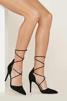 These faux suede pumps feature a pointed toe, a stiletto heel, a lace-up design, and an exposed back zipper.