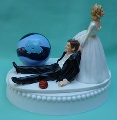 I like this one too. UNC Wedding cake topper