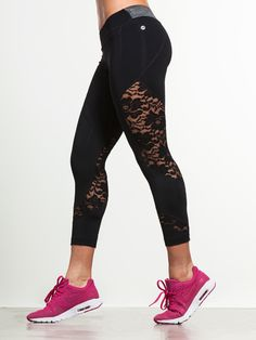"""Need to add a dash of something special to your workout? These pants have just what you're looking for.  With strategically placed lace panels on each leg and a contrasting grey waistband, these leggings are made to move you from """"good"""" to """"excellent""""."""