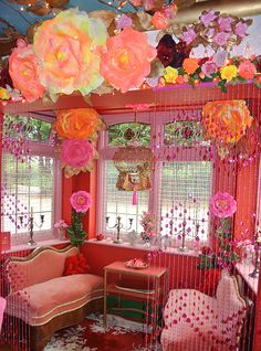 Gorgeous sitting area for a teen girl bedroom. Settees are fabulous but a vintage tufted headboard bed would be fabulous. Love the mix of red and pink patterns