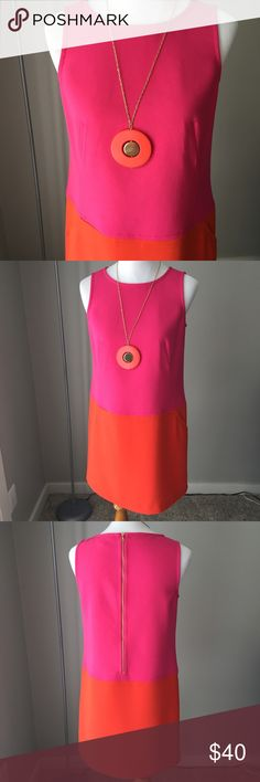 """Loft bright pink & orange dress Gorgeous bright pink and orange mod-style sleeveless shift dress by Loft. Flattering seams on front. Has pockets! Exposed goldtone zipper closure on back. Interior brand tag loose (bottom pic #4); could be easily stitched/removed. 63% polyester, 33% rayon, 4% spandex. Fits true to sz. 8. Measures 33"""" top to bottom with 18"""" bust.  Worn 1x & freshly dry cleaned. Excellent condition! LOFT Dresses"""