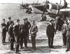 Air crews of No 235 Squadron RAF mill around their Blenheim Mk IVF long-range fighters at RAF Bircham Newton in 1940. The aircraft were armed with 4 .303 Mk II machine guns in special gun packs under the fuselage.