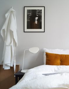nordic bedroom eve mattress the all season duvet. Camel coloured cushion in a light grey bedroom. Muuto leaf lamp. http://tidd.ly/b9e0ff4a