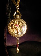 """key To time""  1800s ladies 12 kt gold case  & vintage gold filled chain   WWW.AURIOLUSJEWELRY.COM  A work of Time Art with a collage of components from over a dozen watches and clocks - each over 100 years old. There are approximately 50 rubies throughout the piece. BY -MASTER DESIGNER AND JEWELRY ARTIST DR. DOUGLAS LAYTON"