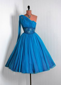 Gorgeous shade of blue tulle1950s one shoulder prom style dress with full skirt