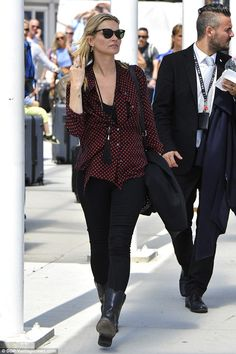 Spot on! Kate Moss, 42, looked effortlessly cool in a black chiffon shirt that was adorned with scarlet polka dots