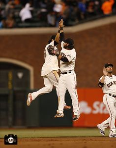 Pagan and Crawford celebrate after the #SFGiants beat the Rockies