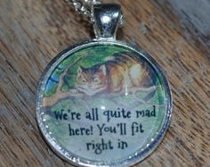 Alice in Wonderland Inspired Silver pendant Necklace - Cheshire Cat Quote